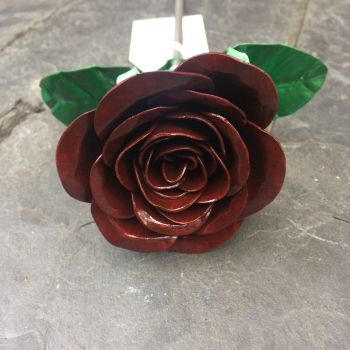 Dark burgundy steel metal rose open