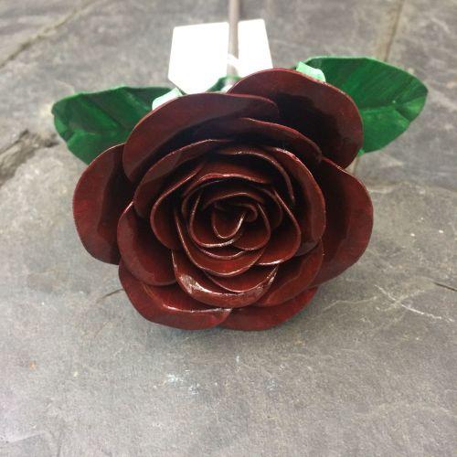 Dark burgundy steel metal rose