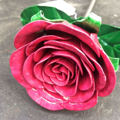 Metal steel rose flower in a vivid shocking pink