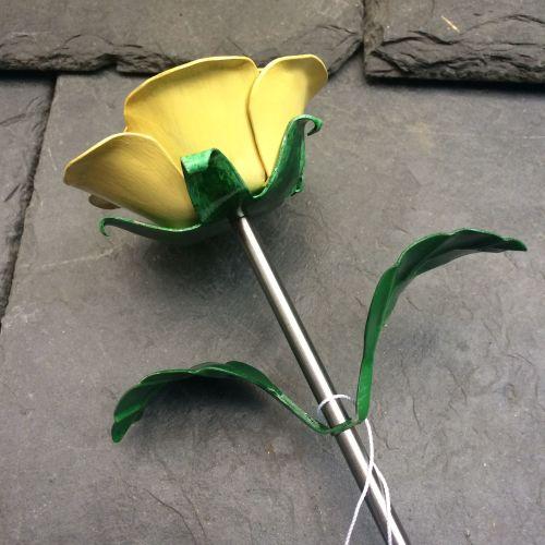 Yellow steel rose, metal rose flower in yellow
