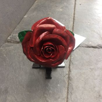 Dark red steel rose with a display stand