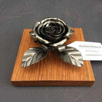 Steel metal rose on an oak plith