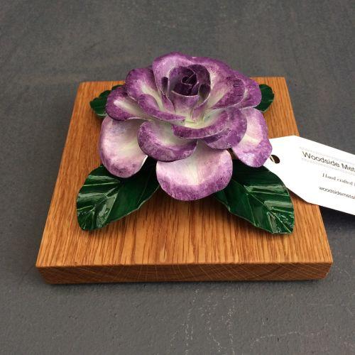 Purple and white steel rose on an oak base