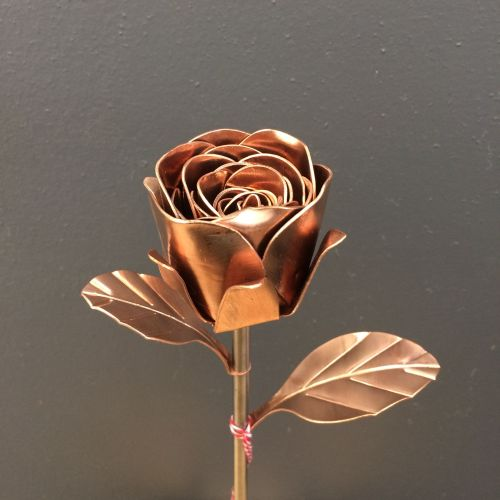 Copper metal rose on a steel stem with copper leaves