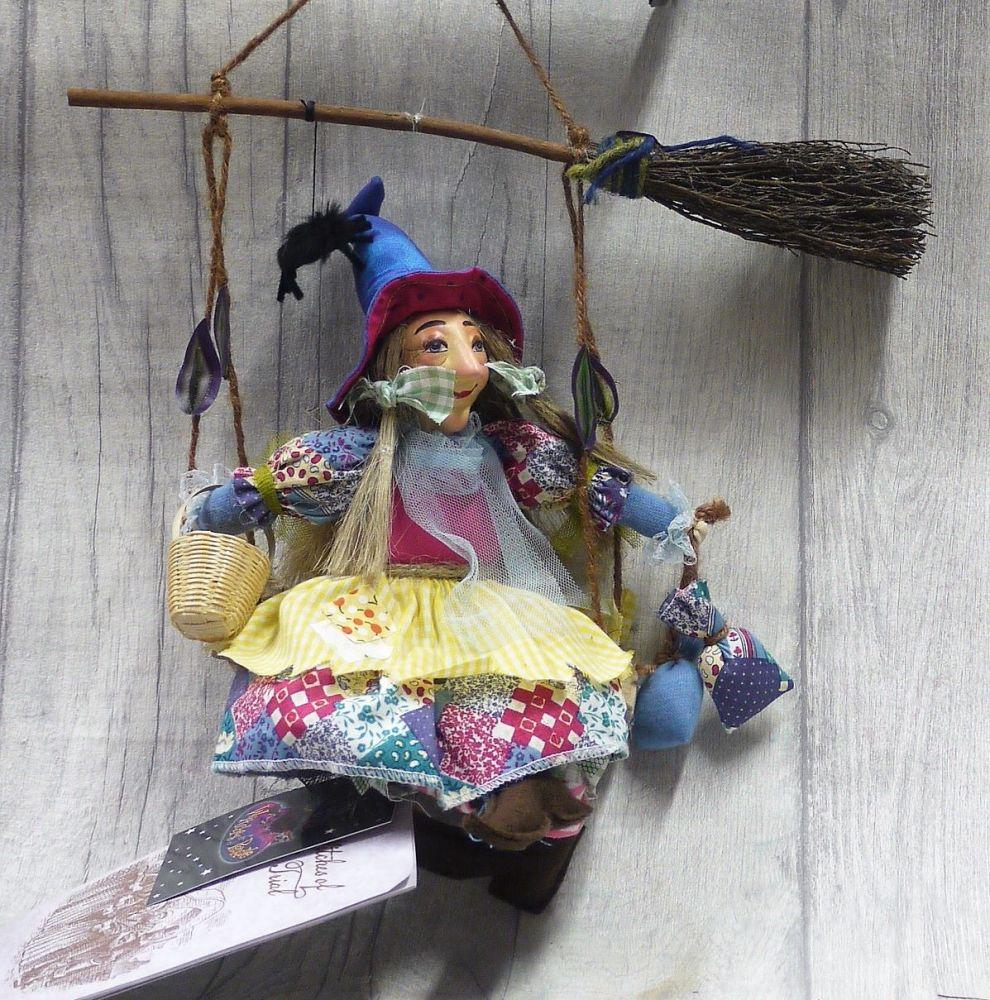 Olivia on swing 24cm Floral