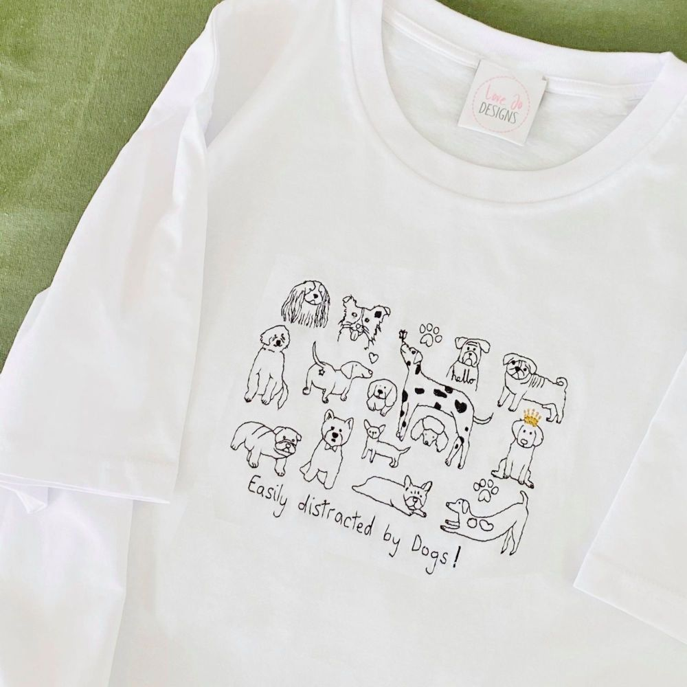 <!-- 001 --> Easily Distracted by Dogs  - Organic Embroidered Tee