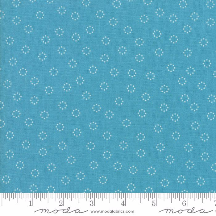 CIRCLES OF DOTS ON MARINE BLUE