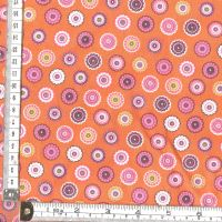 PINK STYLISED FLOWER HEADS ON ORANGE - INPRINT @ MAKOWER  price per half metre