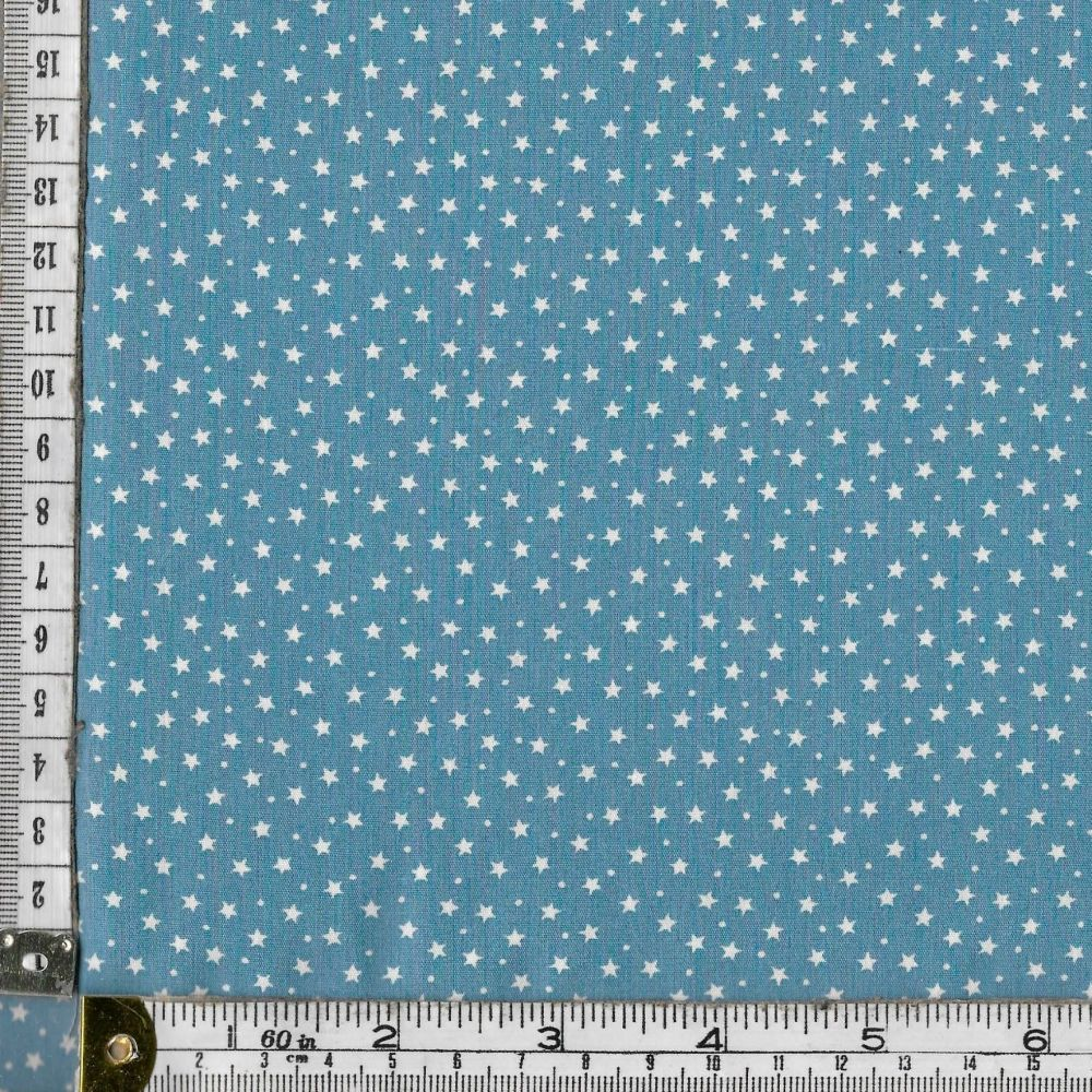 100% premium  cotton poplin  mini white stars on powder blue. Fabric suitable for dressmaking, patchwork and crafts.