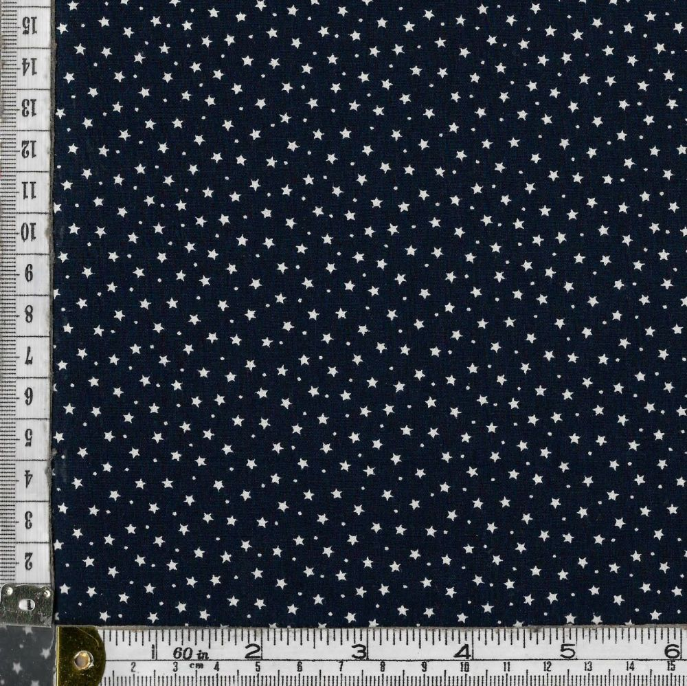 100% premium  cotton poplin  mini white stars on navy blue. Fabric suitable for dressmaking, patchwork and crafts.