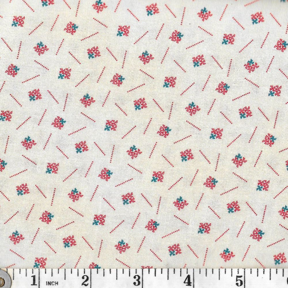All over tiny red/blue design on cream