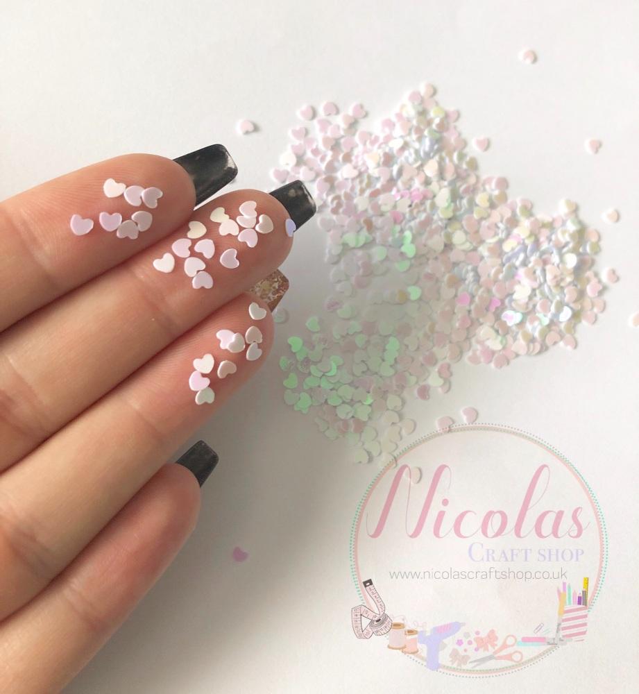 White pink dust heart glitter confetti sprinkles
