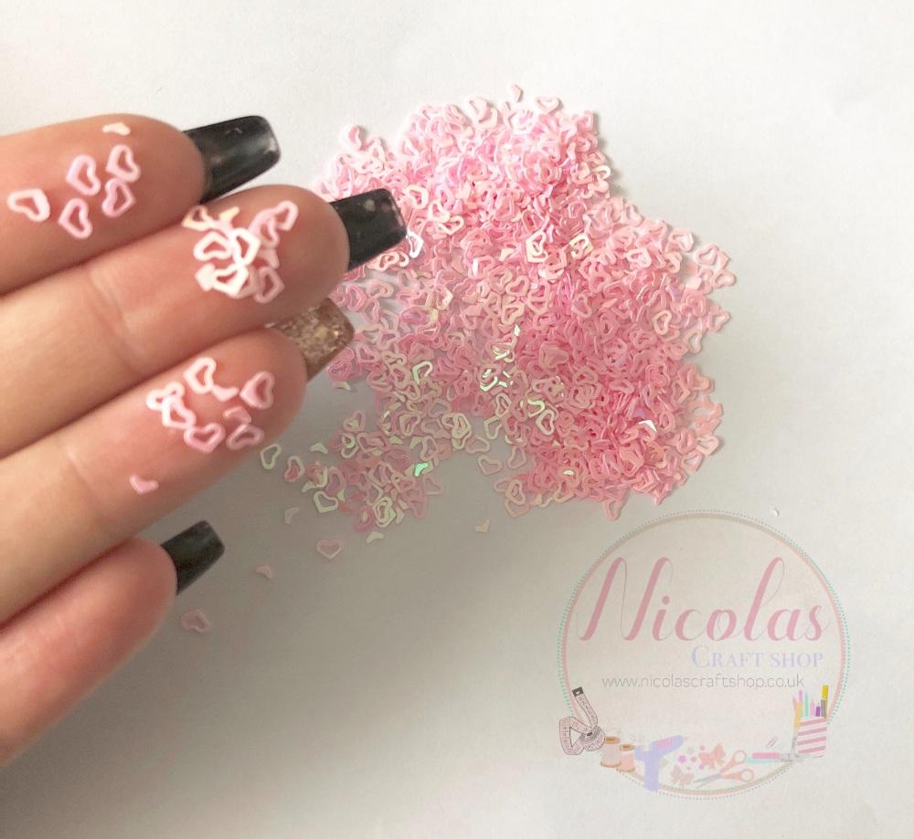 Pink heart glitter confetti sprinkles