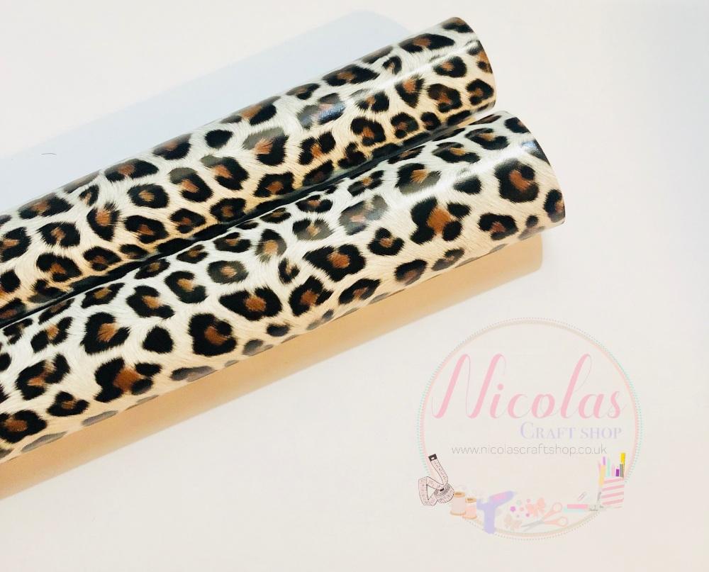 White vinyl leopard print fabric a4