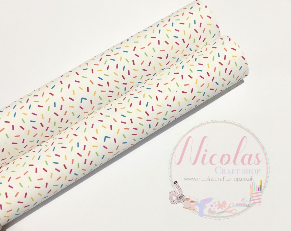 Sprinkles white background printed canvas fabric