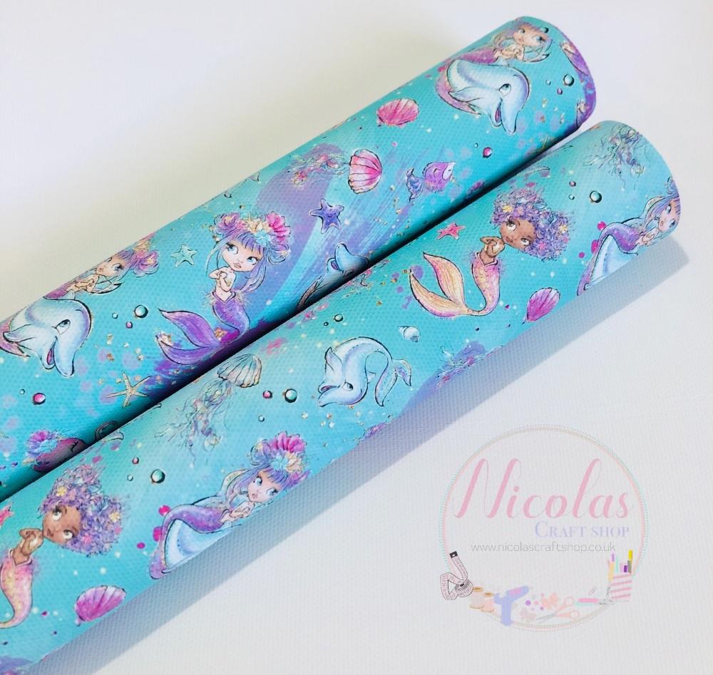 Bright blue aqua mermaid mixed animal printed canvas fabric