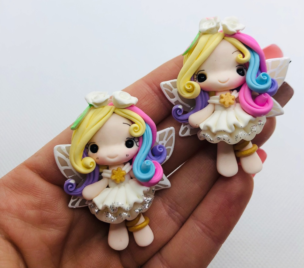 The pastel fairy white wings polymer girl clay
