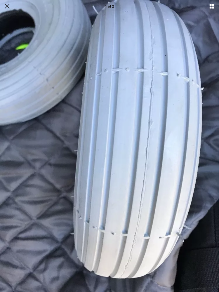 Grey ribbed non marking tyre 300x4