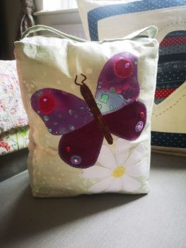 finished Doorstop with applique butterfly