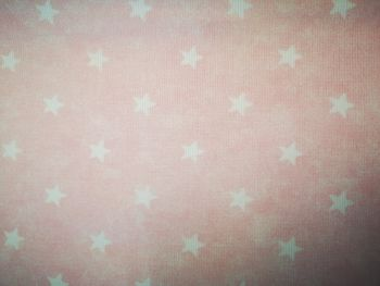 "56"" wide pink with white stars"