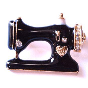 BLACK ENAMEL JEWELLED SEWING MACHINE BROOCH.