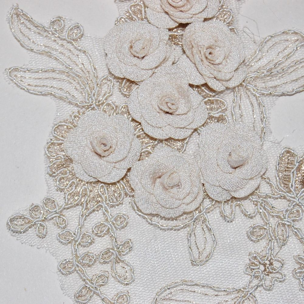 PAIR OF INTRICATE SEW ON EMBELLISHMENTS WITH FLOWERS, ON A VERY FINE NET.