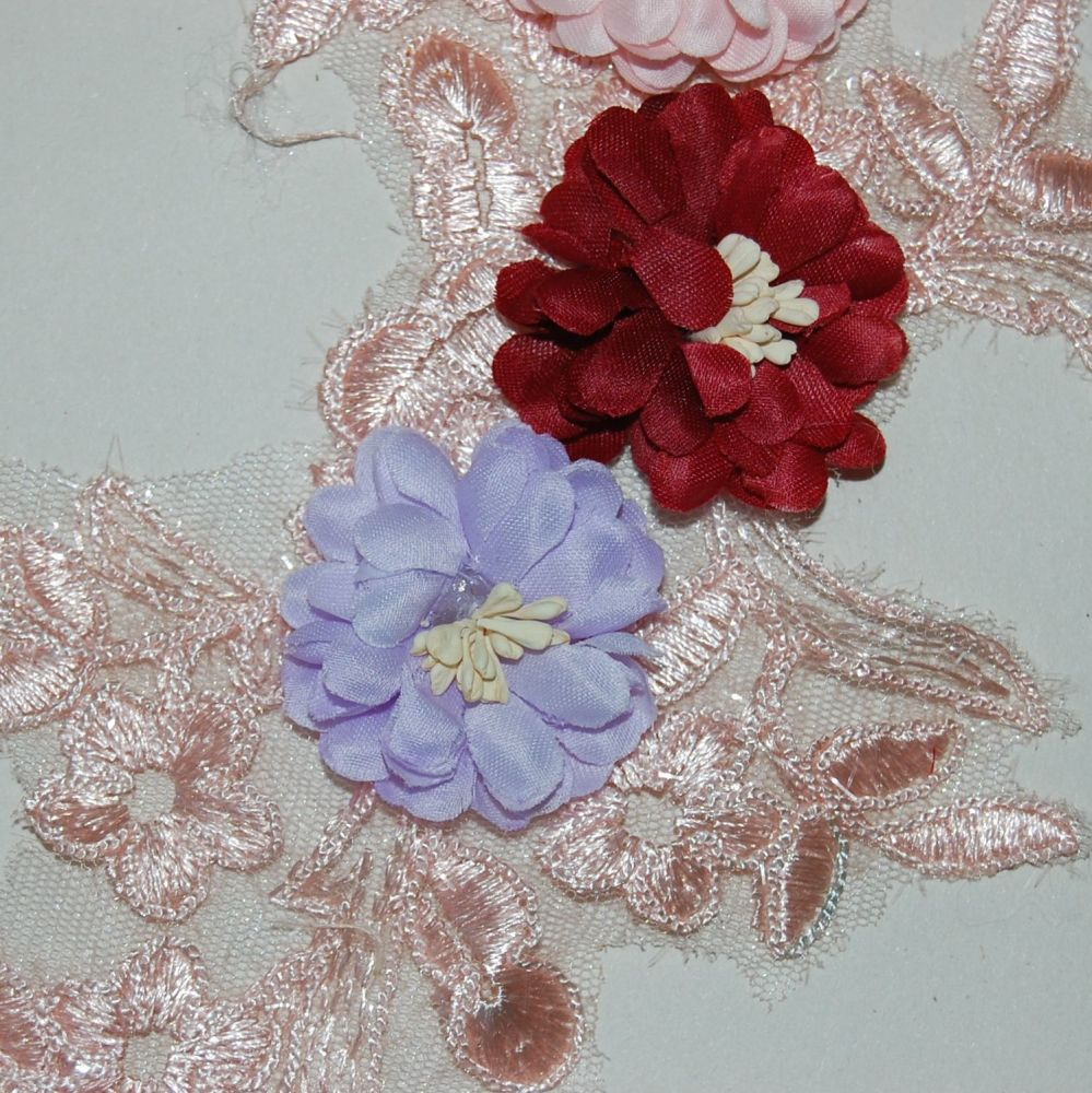 SEW ON EMBELLISHMENT WITH 3 FLOWERS, ON A VERY FINE PEACH NET.