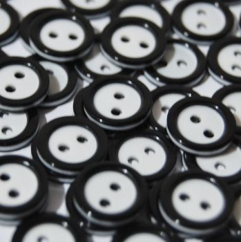 PACK OF 15 2 HOLE 10MM BUTTONS,  IN BLACK AND WHITE.