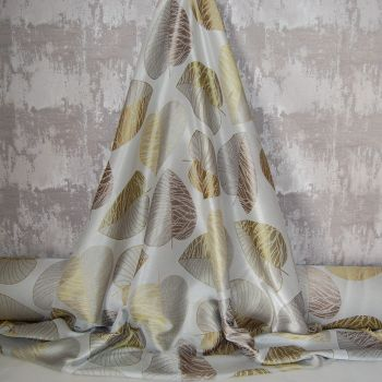 WOVEN COTTON MIX WITH LARGE LEAF PATTERN IN GOLDEN TONES.