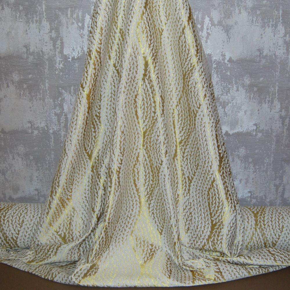 MODERN WOVEN CURTAIN/FURNISHING FABRIC IN CREAM AND GOLD.
