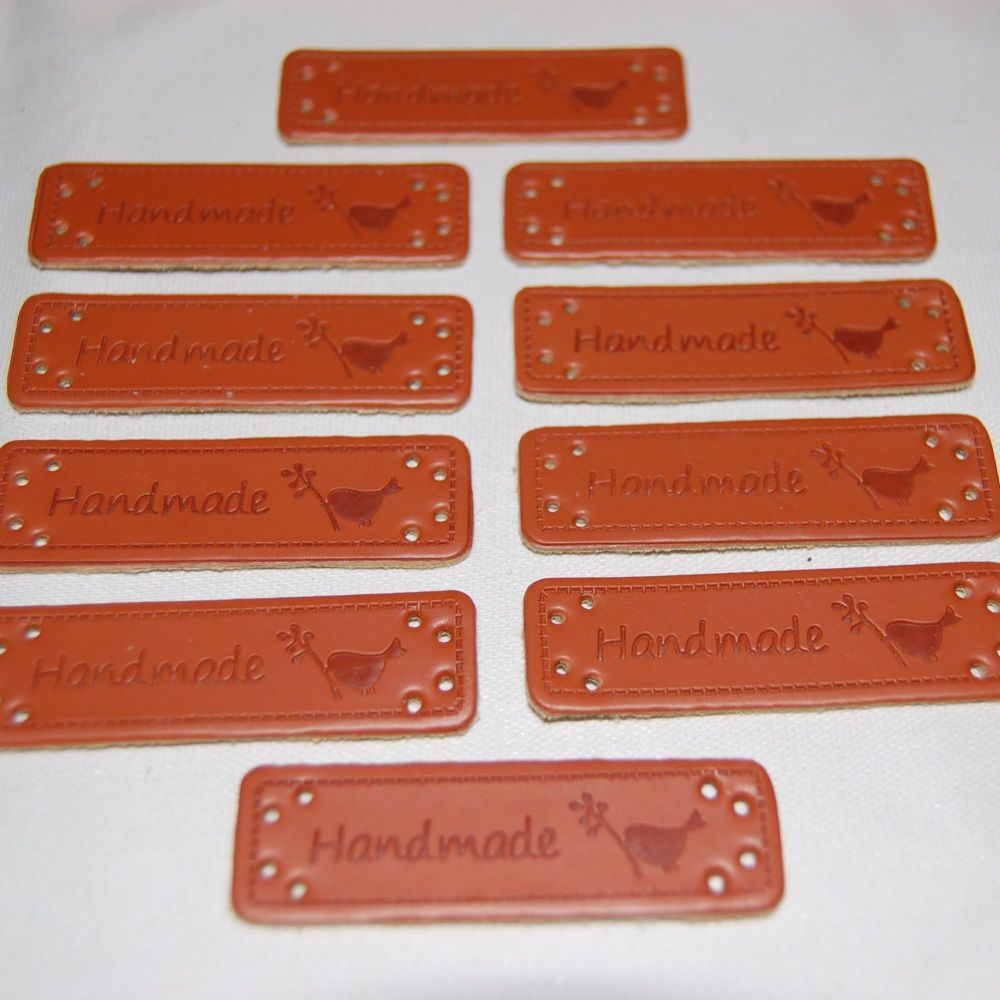PACK OF 10 LEATHER LOOK TAGS. HANDMADE WITH A BIRD.