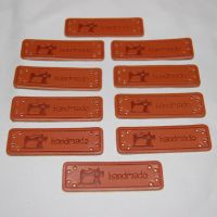 PACK OF 10 LEATHER LOOK TAGS. 'HANDMADE' WITH SEWING MACHINE.