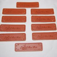 PACK OF 10 LEATHER LOOK TAGS. 'HANDMADE' WITH FLOWERS.