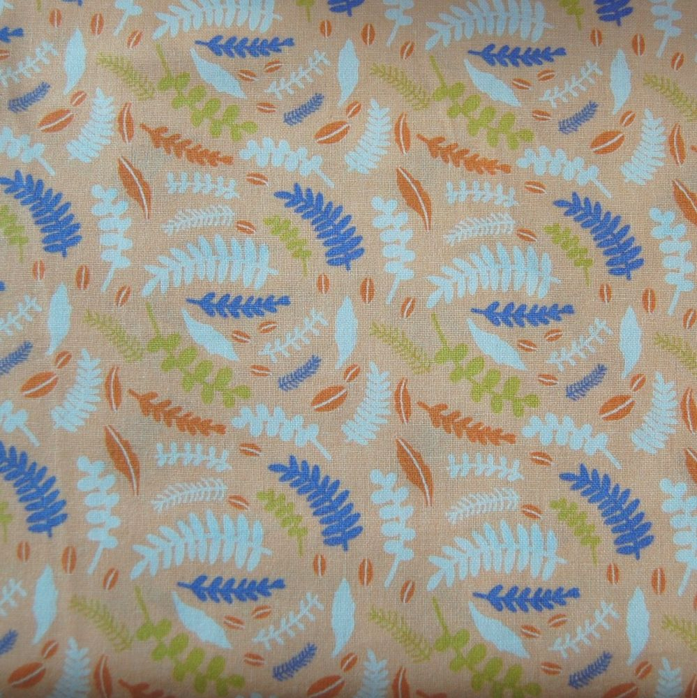 100% COTTON BY THE COTTON CRAFT CO'.  FERNS ON A CORAL BACK.
