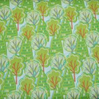 100% COTTON BY THE COTTON CRAFT CO'.  GREEN TREES ON A WHITE BACKGROUND.