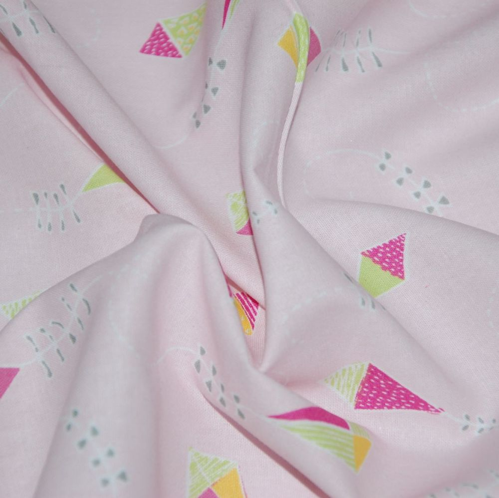FLYING KITES ON A DELICATE PINK BACKGROUND, 100% COTTON.