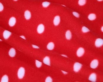 RED AND WHITE POLKA DOT POLAR FLEECE, 58 INCH WIDE.