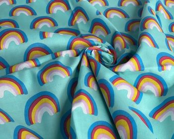 RAINBOWS ON AQUA BACKGROUND, COTTON MIX.