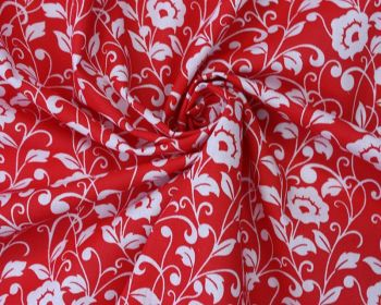 REGAL FLOWERS ON RED, COTTON MIX.