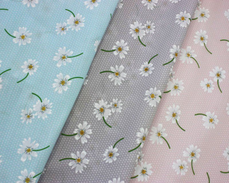 COTTON MIX, WHITE DAISIES ON A SPOT BACKGROUND IN A CHOSE OF 3 COLOURWAYS.