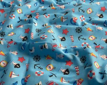 COTTON MIX, SEA THEMED FABRIC PRINT ON A PALE BLUE BACKGROUND.