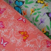 COTTON MIX, BUTTERFLY PRINTS IN A CHOICE OF COLOURS.