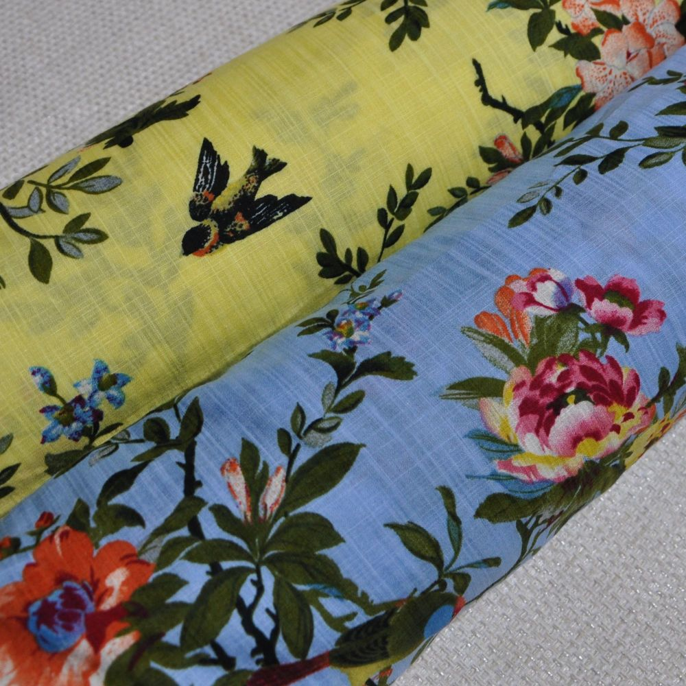 LINEN MIX DRESS WEIGHT FABRIC WITH FAUNA AND BIRDS IN YELLOW OR SKY BLUE