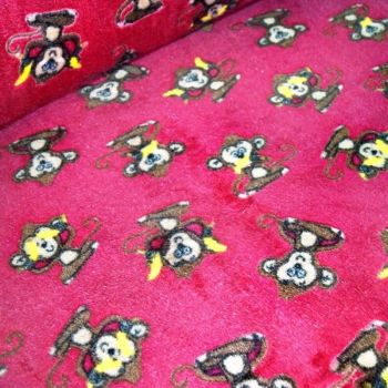 CHEEKY MONKEYS ON CHERRY BACK SUPER SOFT CUDDLE FLEECE, 58 INCH WIDE.