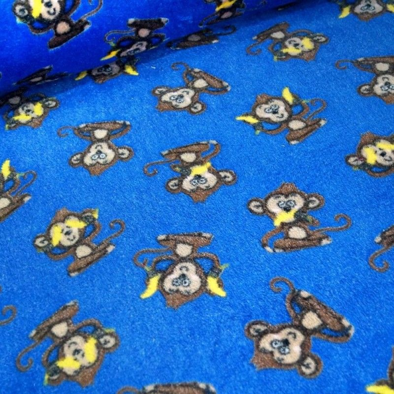 CHEEKY MONKEYS ON ROYAL BLUE BACK SUPER SOFT CUDDLE FLEECE, 58 INCH WIDE.