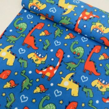 DINOSAURS ON BLUE BACK SUPER SOFT POLAR FLEECE, 58 INCH WIDE.