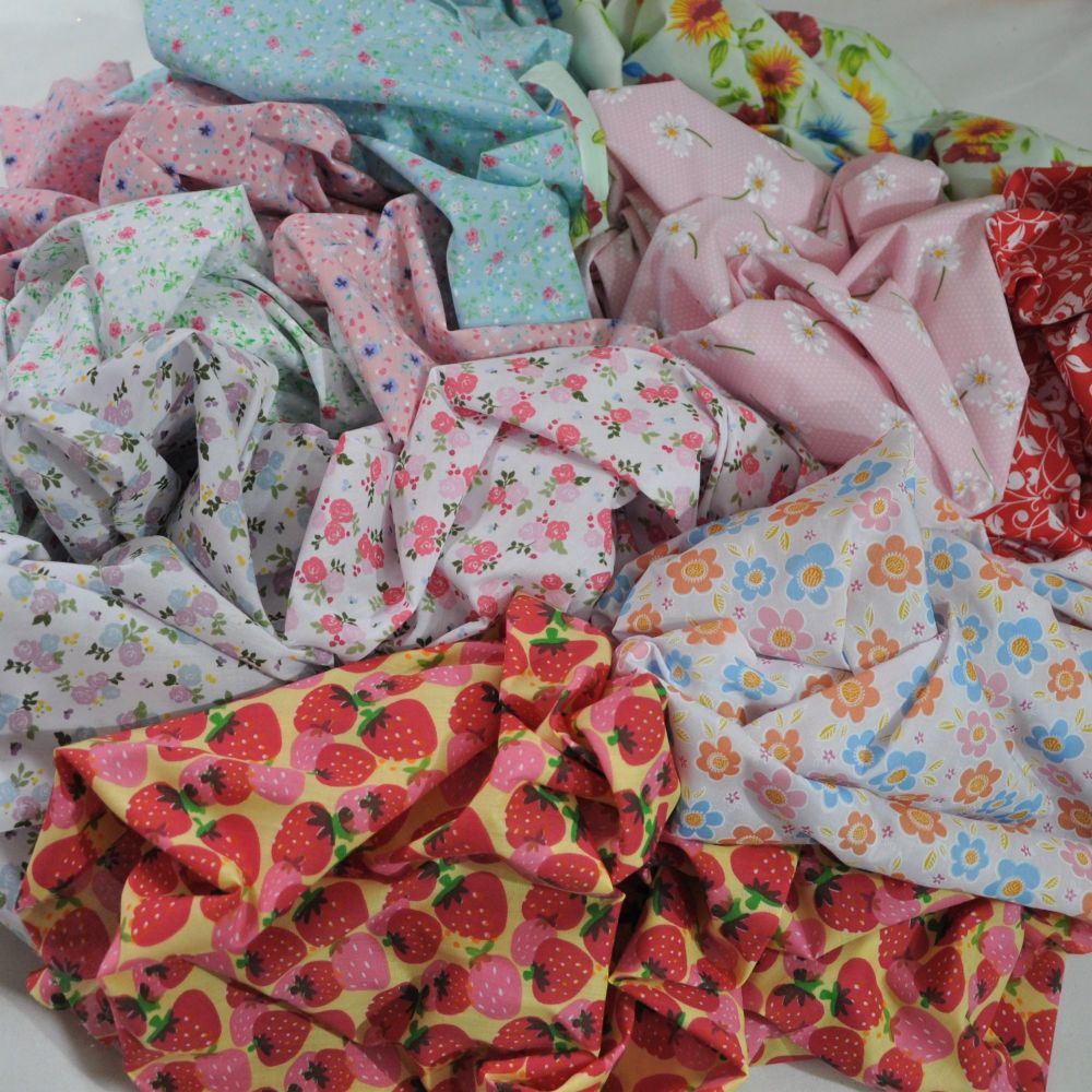 TEN HALF METRES OF PATTERNED POLY COTTONS.