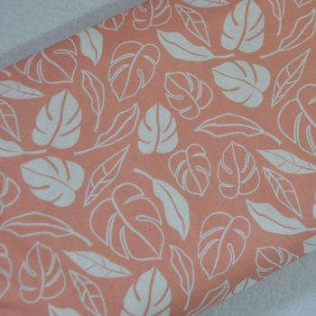 WHITE PALM LEAVES ON CORAL PINK BY CRAFT COTTON COMPANY, 100% COTTON.