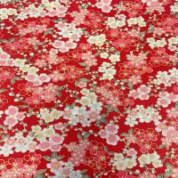 JAPANESE METALLIC 100% COTTON, MED WEIGHT.  SMALL FLORAL ON RED.