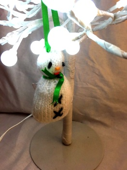 Hand knitted snowman tree decoration by Kernow Knitting